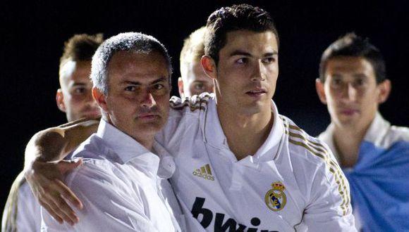 Cristiano Ronaldo y José Mourinho celebraron juntos tres títulos de Real Madrid. (Foto: AFP)