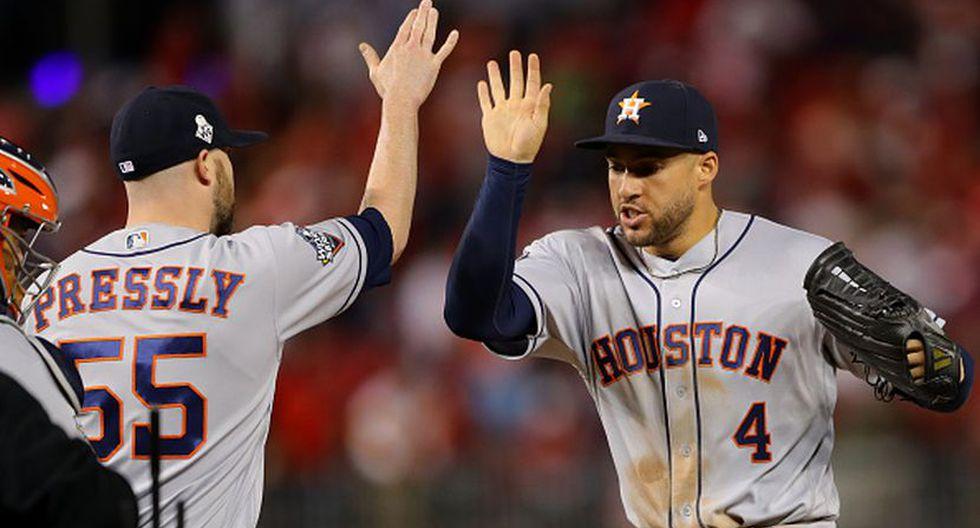 Ryan Pressly y George Springer celebrando la victoria de los Astros. (Foto: Getty Images)