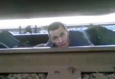 Mira el alucinante escape de un hombre atrapado debajo de un tren en movimiento