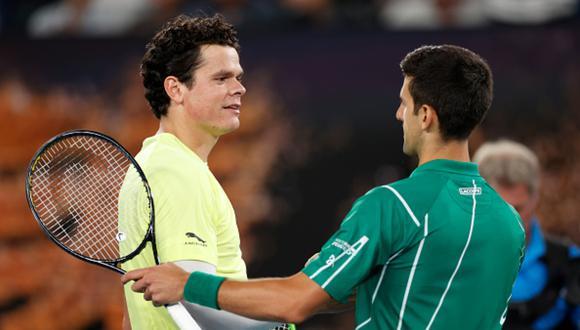 Raonic y Djokovic durante el partido que tuvieron en el Abierto de Australia 2020. (Foto: Getty Images)