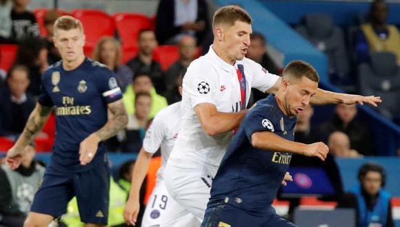 Meunier y Hazard durante el duelo entre PSG y Real Madrid en noviembre de 2019. (Foto: Reuters)