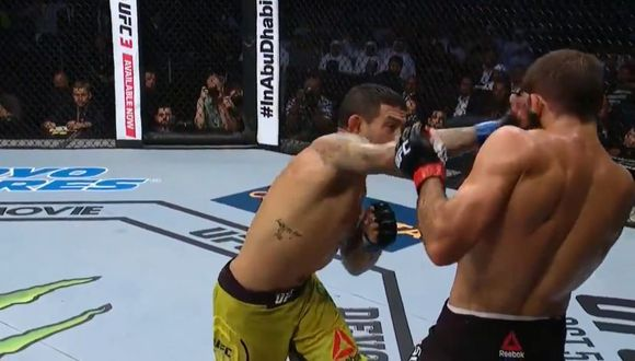 Carlos Diego Ferreira dándole un derechazo a Mairbek Taisumov. (Foto: UFC)
