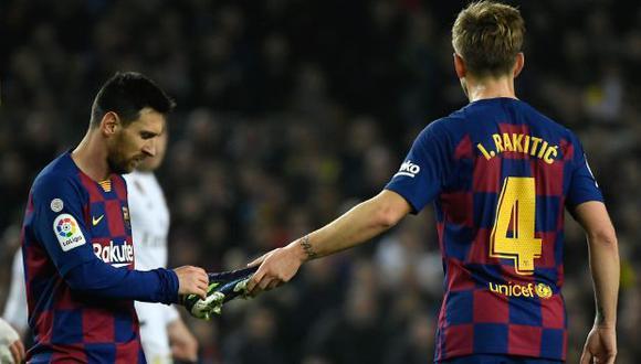 Ivan Rakitic y Lionel Messi coincidieron en seis temporadas en FC Barcelona. (Foto: AFP)