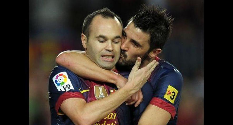 David Villa y Andrés Iniesta compartieron en Barcelona y en la Selección de España. (Getty)