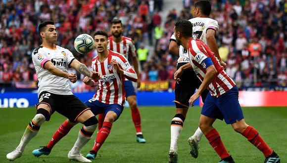 Valencia juega contra Atlético Madrid por LaLiga Santander. Conoce las horas y canales TV para ver todos los partidos de hoy, viernes 14 de febrero. (Foto: AFP)