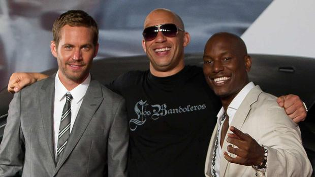While it's hard to imagine the franchise without Roman, the world has Paul Walker to thank for securing his spot with Dom's crew. (Photo: Getty Images)