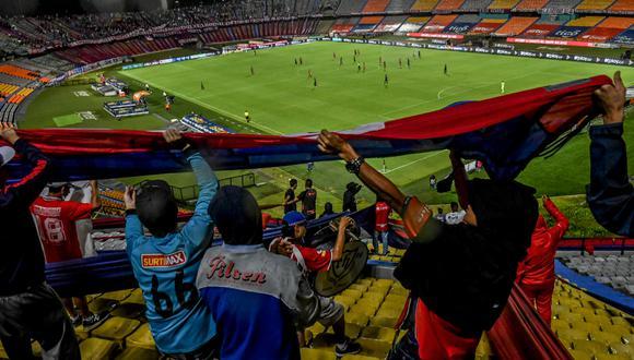 Hubo expectativa por el regreso a los estadios y entradas se agotaron de forma rápida. (Foto: AFP)