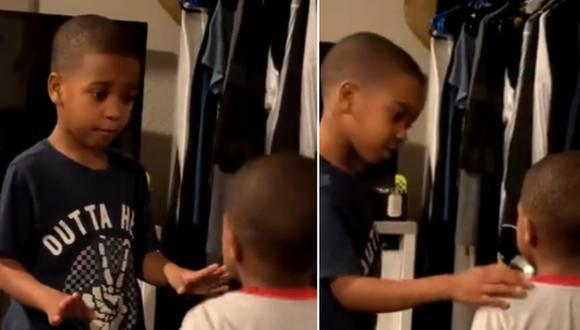 Un niño de 6 años fue captado aplicando un increíble método para evitar que su hermano menor haga una rabieta. (Foto: @Ashleyoutloud / Twitter)